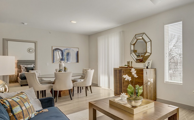 Living Room and dining space with neutral wall paint